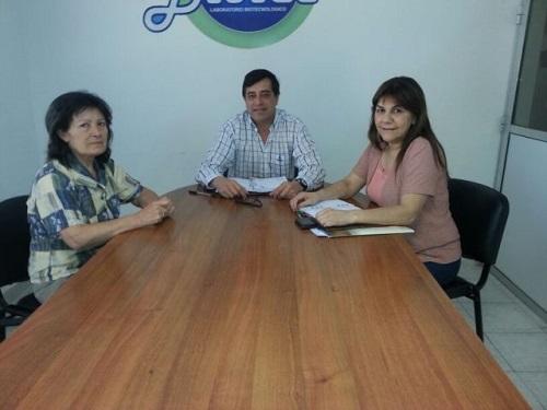 El ministro Décima junto a la decana Molina y la vicedecana Casal
